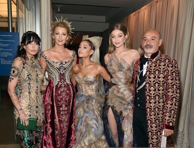 A group shot from the Met Gala with Christian louboutin and Blake lively