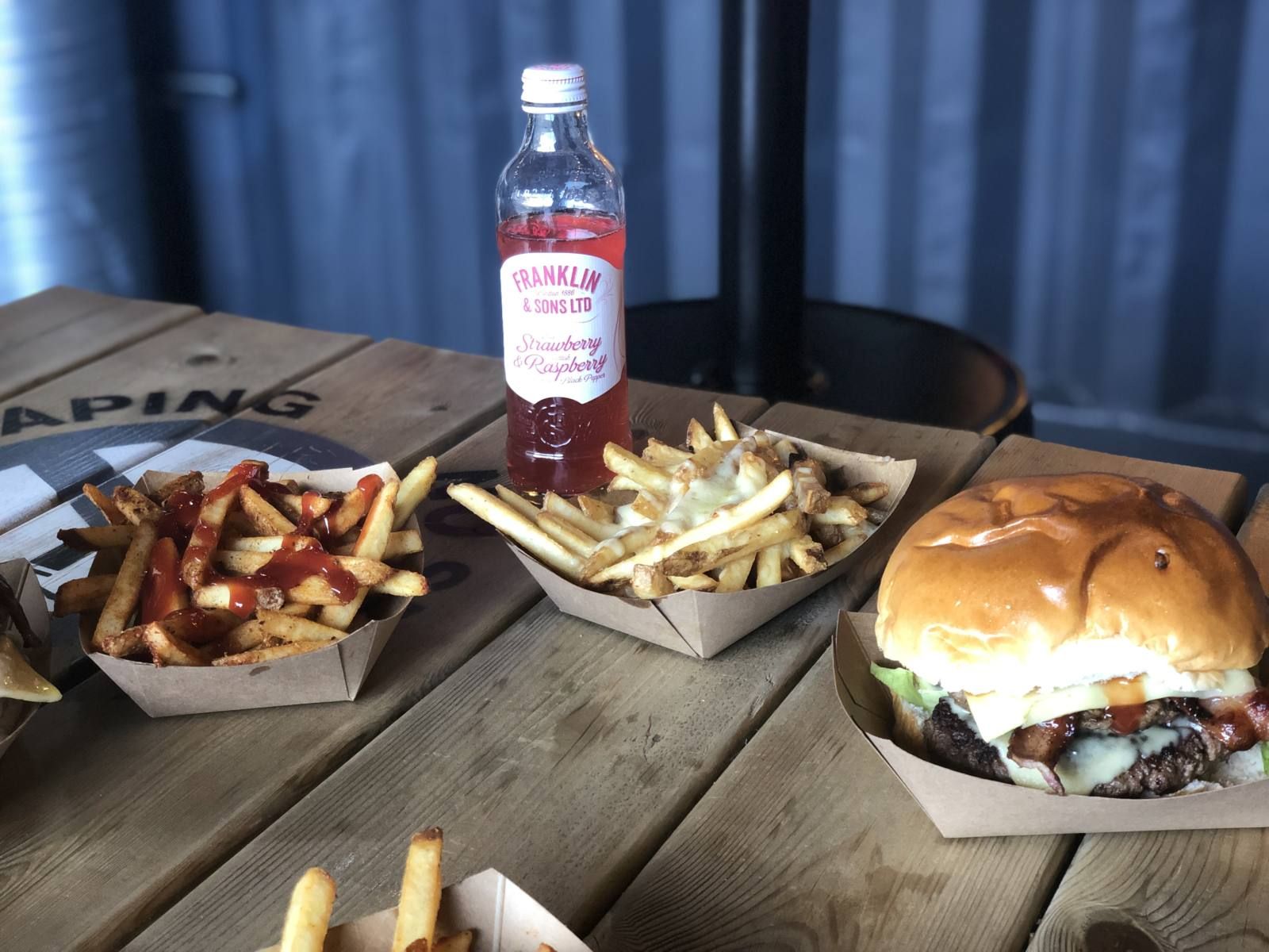An image of burgers and seasoned fries served at Boojie Burger in Stack Newcastle