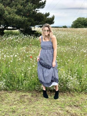 Blogger Pixie Tenenbaum wears a gingham maxi dress with navy blue embroidery from Marks and Spencers Summer 2019 range