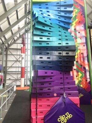 An image of the new Clip n' Climb attraction at Wicksteed Park in Kettering. Brightly coloured clibming walls for children and adults alike!