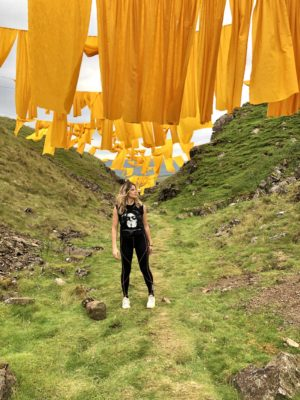 Steve Messam's Hush, a large scale temporary art installation at Bales Hush in Upper Teesdale. Pixie Tenenbaum stands in Bales Hush under the saffron coloured sails. Image taken by Pixie Tenenbaum for Fashion Voyeur