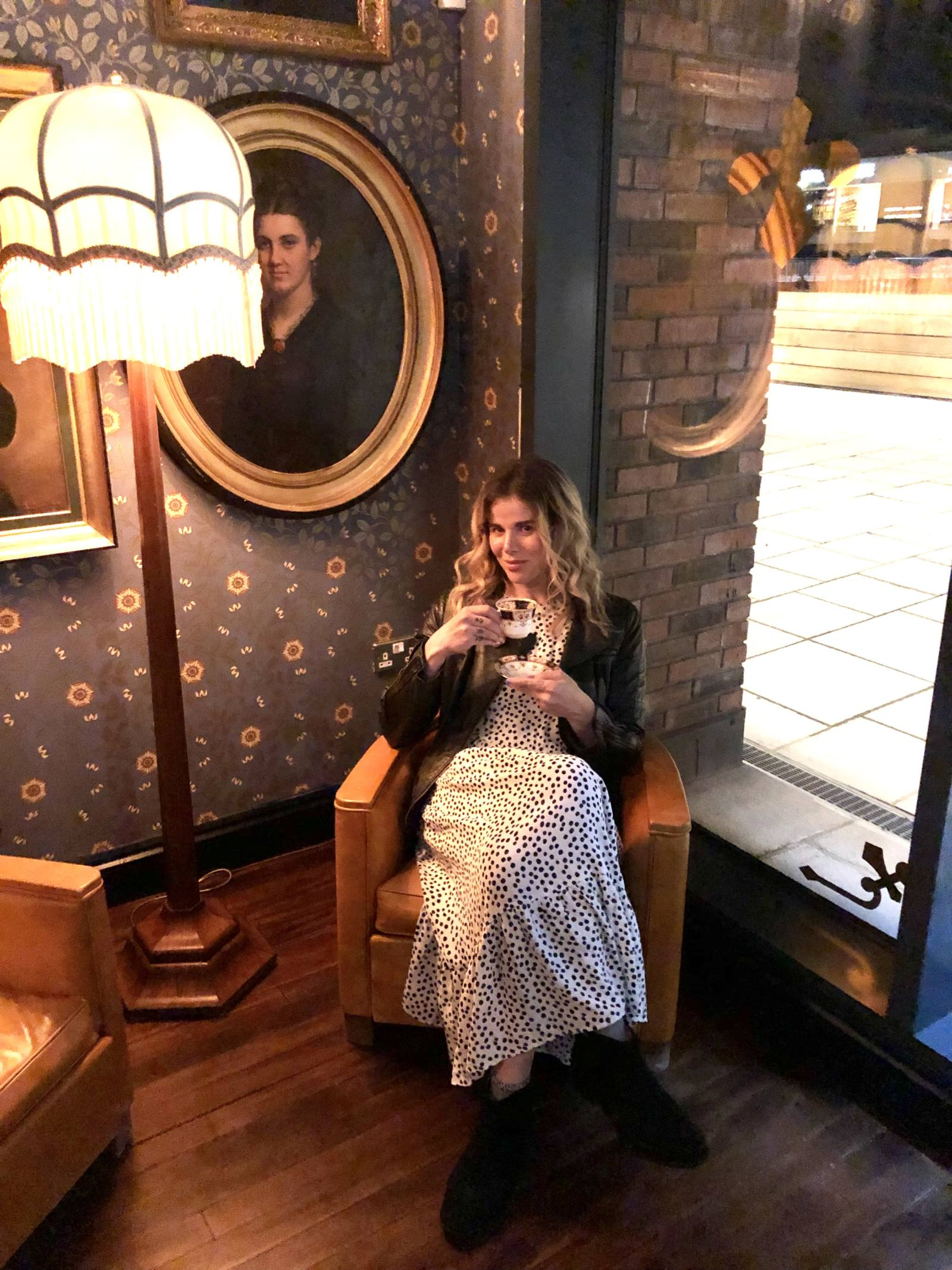 Blogger Pixie Tenenbaum wearing the Zara Hot 4 The Spot dress on Conde Nast's Wear The Dress Dar (August 22nd 2019) at The Cosy Club in Durham City Centre, sitting in a lounge chair drinking from a cup and saucer