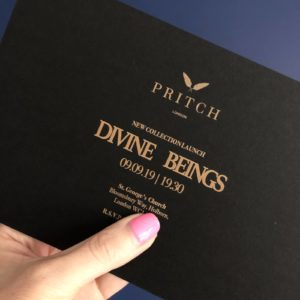 Pixie tenenbaum holds up the invite to the PRITCH London SS20 runway show pre-London Fashion Week in September 2019