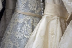A close up image of some off the rack formal gowns