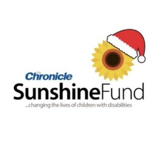 The Chronicle Sunshine Fund Logo with a Santa hat on it for Christmas!
