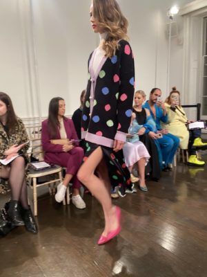A model wears polka dots on the runway at the Olivia Rubin Fall Winter presentation at london Fashion Week