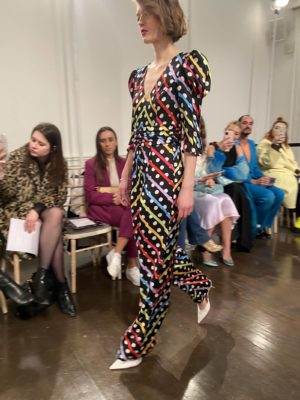 A model wears 80's style polka dots on the runway at the Olivia Rubin Fall Winter presentation at london Fashion Week