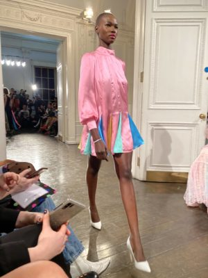 A model wears pink silk tiers on the runway at the Olivia Rubin Fall Winter presentation at london Fashion Week
