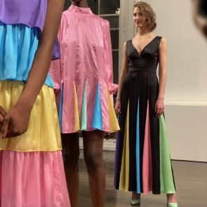 An image of 3 models at the Olivia Rubin fashion presentation at London Fashion Week wearing rainbow coloured silk tiered dresses. - Fashion Voyeur Blog